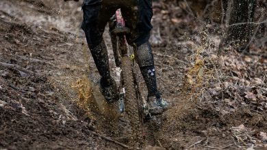 A rider going flat out through mud